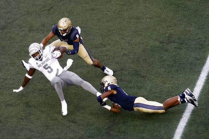 Memphis tight end Sean Dykes (5) is tackled by Navy safety Sean Williams, right, and linebacker Elan Nash in the first half of an NCAA college football game, Saturday, Sept. 8, 2018, in Annapolis, Md. (AP Photo/Patrick Semansky)