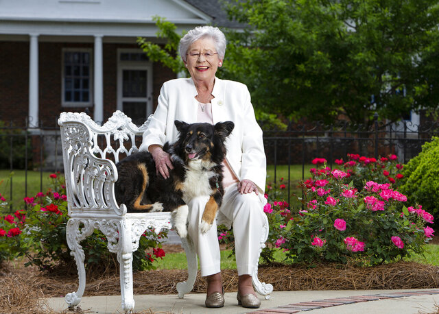 """This photo provided by the Office of Alabama Gov. Kay Ivey, shows Ivey and her dog Missy. Ivey fractured her shoulder after being tripped by the state's """"first dog,"""