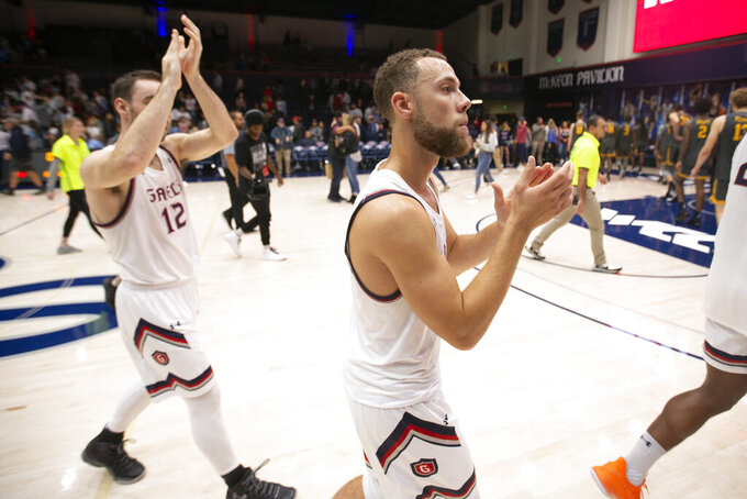 Saint Mary's guards Tommy Kuhse (12) and Jordan Ford walk off the court following the team's NCAA college basketball game against Long Beach State on Thursday, Nov. 14, 2019, in Moraga, Calif. Saint Mary's won 81-63. (AP Photo/D. Ross Cameron)
