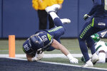 Seattle Seahawks tight end Will Dissly tumbles into the end zone on a touchdown against the New York Jets during the second half of an NFL football game, Sunday, Dec. 13, 2020, in Seattle. (AP Photo/Lindsey Wasson)