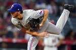 Texas Rangers starting pitcher A.J. Alexy throws to the Los Angeles Angels during the fourth inning of a baseball game Monday, Sept. 6, 2021, in Anaheim, Calif. (AP Photo/Marcio Jose Sanchez)