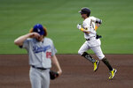 San Diego Padres' Jake Cronenworth, right, rounds the bases after hitting a home run off Los Angeles Dodgers starting pitcher Dustin May, left, during the fourth inning of a baseball game Tuesday, Aug. 4, 2020, in San Diego. (AP Photo/Gregory Bull)