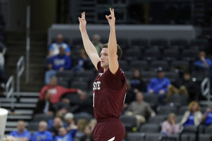 Missouri State's Ross Owens celebrates after making a 3-point basket during the first half of an NCAA college basketball game against Indiana State in the quarterfinal round of the Missouri Valley Conference men's tournament Friday, March 6, 2020, in St. Louis. (AP Photo/Jeff Roberson)