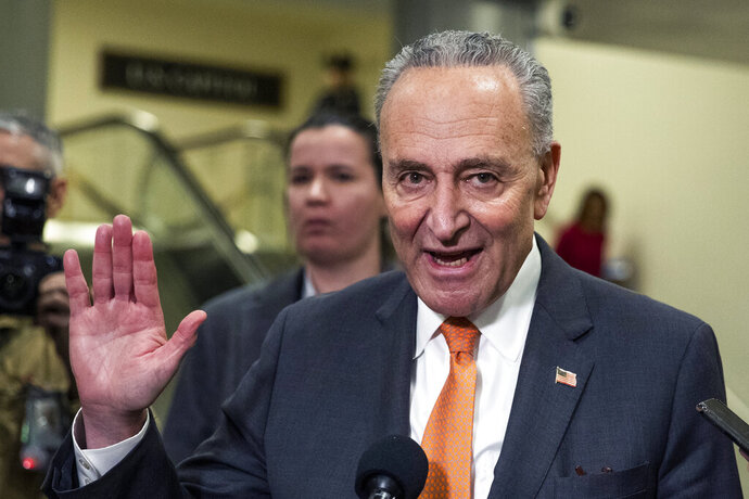 Senate Minority Leader Chuck Schumer, D-N.Y., gestures as he talks to media at the Capitol in Washington, Tuesday, Jan.28, 2020. (AP Photo/Manuel Balce Ceneta)