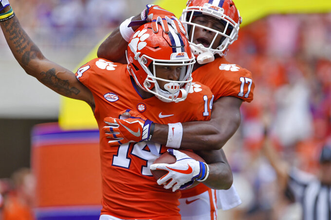 Clemson's Diondre Overton, front, and Cornell Powell celebrate Overton's touchdown during the first half of an NCAA college football game against Furman Saturday, Sept. 1, 2018, in Clemson, S.C. (AP Photo/Richard Shiro)