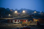 FILE - In this Aug. 15, 2019, file photo, early morning fog shrouds homes in Kulusuk, Greenland. As warmer temperatures cause the ice to retreat the Arctic region is taking on new geopolitical and economic importance, and not just the United States hopes to stake a claim, with Russia, China and others all wanting in. (AP Photo/Felipe Dana, File)