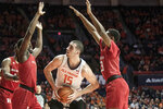Illinois' Giorgi Bezhanishvili (15) looks for an open shot as he is pressured by Rutgers' Akwasi Yeboah (1) and Nick Brooks (3) in the first half of an NCAA college basketball game, Sunday, Jan. 11, 2020, in Champaign, Ill. (AP Photo/Holly Hart)