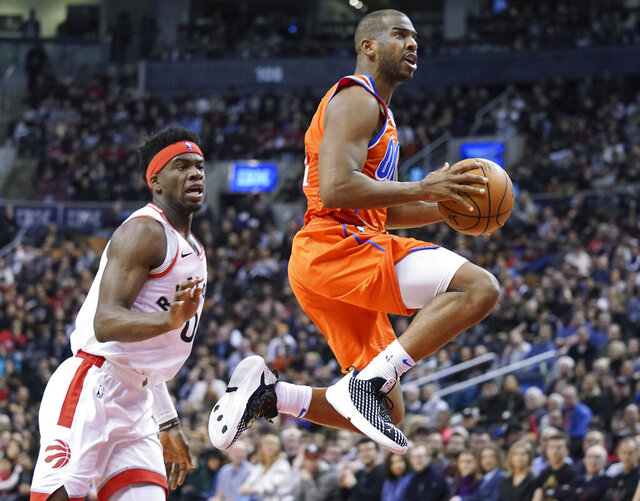 Oklahoma City Thunder Chris Paul (3) drives to the basket through the defense of Toronto Raptors Terence Davis II (0) during fourth quarter NBA basketball action in Toronto on Sunday, Dec. 29, 2019. (Hans Deryk/The Canadian Press via AP)