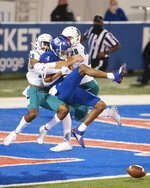 Kansas wide receiver Andrew Parchment gets tackled by Coastal Carolina defenders in the second half of an NCAA college football game in Lawrence, Kan., Saturday, Sept. 12, 2020. (Evert Nelson/The Topeka Capital-Journal via AP)