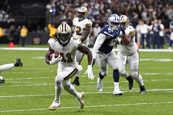 New Orleans Saints running back Alvin Kamara (41) carries near the goal line in the first half of an NFL football game against the Dallas Cowboys in New Orleans, Sunday, Sept. 29, 2019. (AP Photo/Bill Feig)