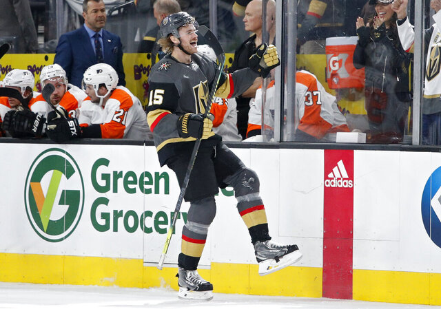 Vegas Golden Knights defenseman Jon Merrill (15) celebrates after scoring against the Philadelphia Flyers during the first period of an NHL hockey game Thursday, Jan. 2, 2020, in Las Vegas. (AP Photo/John Locher)