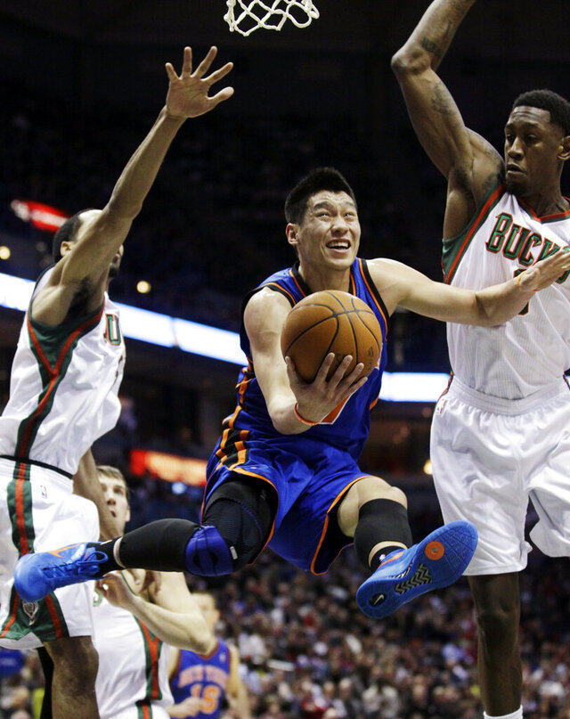 FILE - This March 9, 2012 file photo shows New York Knicks' Jeremy Lin shooting between Milwaukee Bucks' Shaun Livingston, left, and Larry Sanders during the first half of an NBA basketball game in Milwaukee. Linsanity is finally getting another run on MSG Network. In search of content to fill with no games because of the coronavirus, the network is turning to Jeremy Lin's memorable NBA breakthrough, which was once ratings gold. The network said Friday, April 24, 2020 it will dedicate a week of programming to the 2012 stretch when Lin got his chance with the New York Knicks and took the league by storm.(AP Photo/Morry Gash, File)