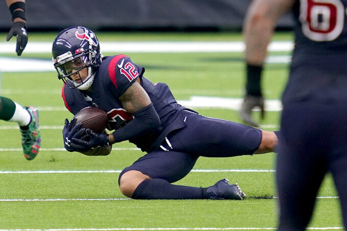Houston Texans wide receiver Kenny Stills (12) catches a pass during the second half of an NFL football game against the Green Bay Packers Sunday, Oct. 25, 2020, in Houston. (AP Photo/Sam Craft)