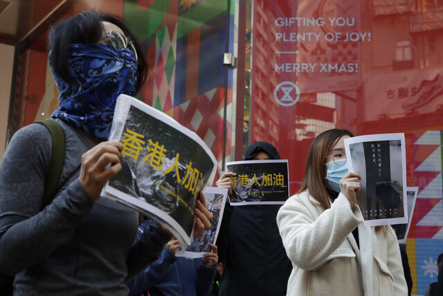 Pro-democracy supporters and office workers protest in Causeway Bay in Hong Kong, Wednesday, Dec. 11, 2019. Hong Kong Chief Executive Carrie Lam on Tuesday again ruled out further concessions to protesters who marched peacefully in their hundreds of thousands this past weekend, days before she is to travel to Beijing for regularly scheduled meetings with Communist Party leaders. (AP Photo/Mark Schiefelbein)