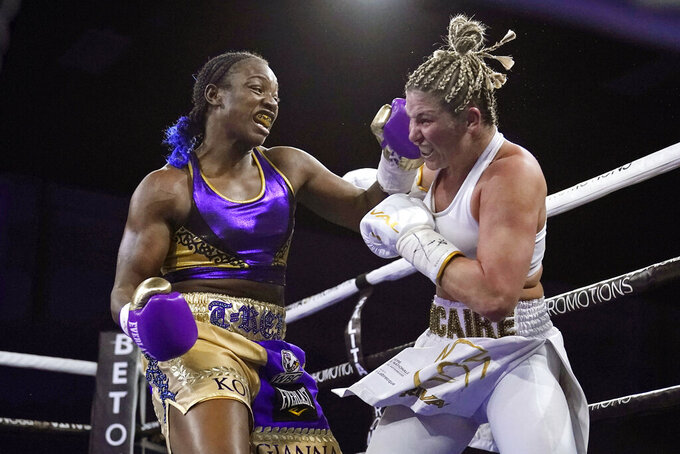 FILE - In this March 5, 2021, file photo, Claressa Shields, left, hits Marie-Eve Dicaire with a left during the fifth round of a boxing bout for the women's super welterweight title in Flint, Mich. Shields did it all in boxing. Two-time Olympic gold medalist. Professional titles in three weight classes. Now she'll try to conquer MMA, starting with her pro debut for Professional Fighters League on Thursday night, June 10, 2021, in Atlantic City, N.J.  (AP Photo/Carlos Osorio, File)