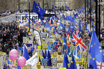 Demonstrators carry posters and flags during a Peoples Vote anti-Brexit march in London, Saturday, March 23, 2019. The march, organized by the People's Vote campaign is calling for a final vote on any proposed Brexit deal. This week the EU has granted Britain's Prime Minister Theresa May a delay to the Brexit process. (AP Photo/Tim Ireland)
