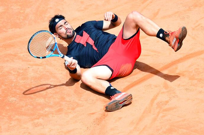 Italy's Fabio Fognini falls as he returns the ball to Austria's Dominic Thiem during their Italian Open tennis tournament match, in Rome, Wednesday, May 16, 2018. (Ettore Ferrari/ANSA via AP)