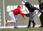 Detroit Tigers' Josh Harrison is tagged out at second by Boston Red Sox second baseman Dustin Pedroia as he tries to stretch a single in the first inning of a spring training baseball game Tuesday, March 12, 2019, in Fort Myers, Fla. (AP Photo/John Bazemore)