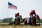 Jockey Jose Ortiz (3) reacts after riding Letruska across the finish line to win the 53rd running of the Ogden Phipps horse race Saturday, June 5, 2021, at Belmont Park in Elmont, N.Y. (AP Photo/John Minchillo)