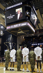 Former Vanderbilt athletic director David Williams is honored before an NCAA college basketball game between Vanderbilt and Alabama, Saturday, Feb. 9, 2019, in Nashville, Tenn. Williams, the first black athletic director in the Southeastern Conference, died Friday. He was 71. (AP Photo/Mark Humphrey)