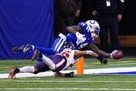 Indianapolis Colts wide receiver Zach Pascal (14) goes over Houston Texans cornerback Vernon Hargreaves III (26) for a touchdown in the second half of an NFL football game in Indianapolis, Sunday, Dec. 20, 2020. (AP Photo/AJ Mast)