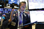 Trader Gregory Rowe works on the floor of the New York Stock Exchange, Wednesday, June 19, 2019. Investors are in wait-and-see mode hours ahead of a widely anticipated Federal Reserve decision on interest rates. (AP Photo/Richard Drew)