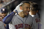 Houston Astros' Carlos Correa reacts in the dugout after hitting a three-run home run against the New York Yankees during the sixth inning of Game 4 of baseball's American League Championship Series, Thursday, Oct. 17, 2019, in New York. (AP Photo/Frank Franklin II)