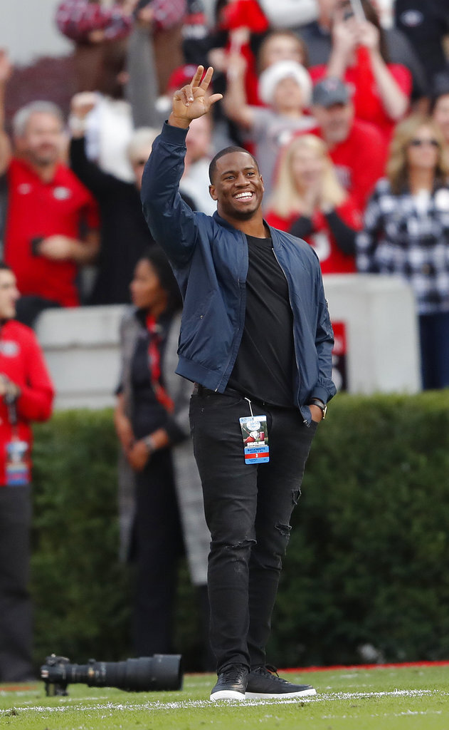 Former Georgia and current Cleveland Browns running back Nick Chubb waves to the crowd as he a recognized during the first half of an NCAA college football game against Massachusetts Saturday, Nov. 17, 2018, in Athens, Ga. (AP Photo/John Bazemore)