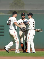 San Francisco Giants left fielder Alex Dickerson (8), center fielder Kevin Pillar, center, and right fielder Mike Yastrzemski congratulate each other after the team's 8-3 victory over the Colorado Rockies in a baseball game Thursday, Sept. 26, 2019, in San Francisco. (AP Photo/Tony Avelar)