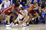 Duke forward Matthew Hurt reaches for the ball between Boston College forwards CJ Felder and Steffon Mitchell, right, during the first half of an NCAA basketball game in Durham, N.C., Tuesday, Dec. 31, 2019. (AP Photo/Gerry Broome)