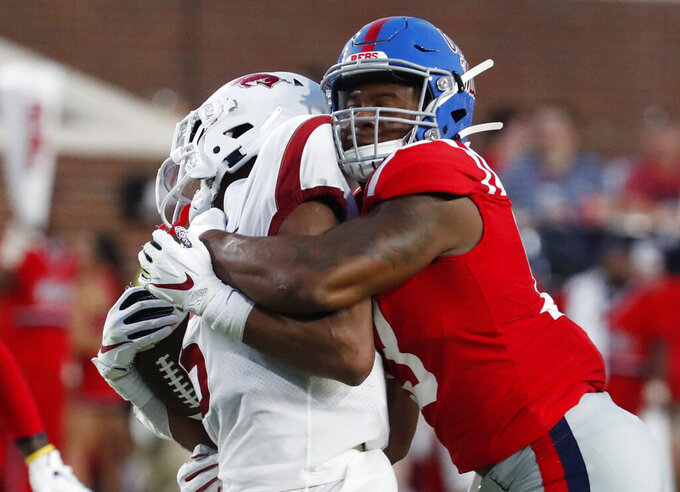 Mississippi linebacker Sam Williams (13) locks up Arkansas running back Rakeem Boyd (5) behind the line of scrimmage during the first half of their NCAA college football game, Saturday, Sept. 7, 2019, in Oxford, Miss. (AP Photo/Rogelio V. Solis)