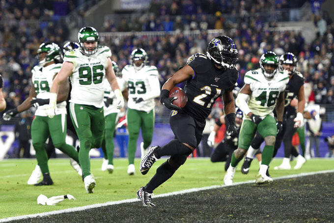 "File-This Dec. 12, 2019, file photo shows Baltimore Ravens running back Mark Ingram (21) scoring on a two-point conversion against the New York Jets during the first half of an NFL football game, in Baltimore. As he draws closer to a milestone birthday,  Ingram wants everyone to know he's still got what it takes to score a bunch of touchdowns, rush for 1,000 yards and earn an invite to the Pro Bowl. ""I feel like people say when you're 30 you're dead,"" Ingram said Wednesday. ""I turn 30 at the end of this week, but my best football is ahead of me."" (AP Photo/Gail Burton, File)"