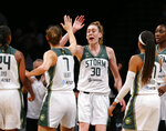 Seattle Storm forwards Stephanie Talbot (7) and Breanna Stewart (30) celebrate after a score against the New York Liberty during the second half of a WNBA basketball game Friday, Aug. 20, 2021, in New York. (AP Photo/Noah K. Murray)
