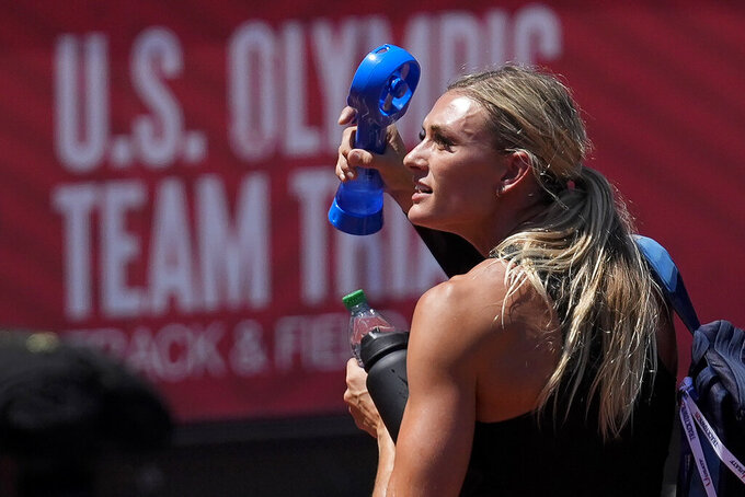 Annie Kunz cools off with a fan after the heptathlon javelin throw at the U.S. Olympic Track and Field Trials Sunday, June 27, 2021, in Eugene, Ore. (AP Photo/Ashley Landis)
