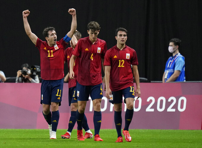 Spain's Mikel Oyarzabal, left, raises his arms in jubilation after scoring his side's first goal against Australia during a men's soccer match at the 2020 Summer Olympics, Sunday, July 25, 2021, in Sapporo, Sapporo, Japan. (AP Photo/Silvia Izquierdo)