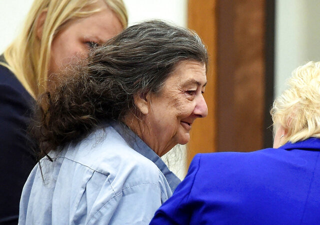 FILE - In this Sept. 8, 2014 file photo, Cathy Woods appears in Washoe District court in Reno, Nev. Woods, who spent 35 years in prison for a murder she didn't commit before she was exonerated by DNA evidence, will receive $3 million under a settlement approved by the Reno City Council. Woods was arrested and wrongfully convicted for the 1976 murder of 19-year-old University of Nevada, Reno student Michelle Mitchell. She was released from prison in 2015 when new evidence linked the murder to an Oregon inmate (Andy Barron/The Reno Gazette-Journal via AP, File)