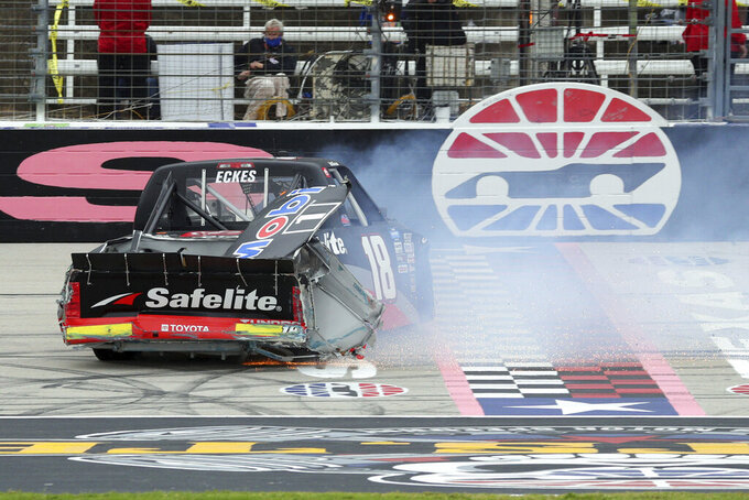 NASCAR Texas Trucks Series driver Christian Eckes (18) skids out on the front stretch after contact from another vehicle during an auto race at Texas Motor Speedway in Fort Worth, Texas, Sunday, Oct. 25, 2020. (AP Photo/Richard W. Rodriguez)