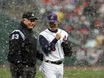 FIULE - In this April 6, 2007, file photo, umpire Rick Reed (23) laughs with Cleveland Indians pitcher Paul Byrd (36) after snow delayed the baseball game between the Indians and the Seattle Mariners, in Cleveland. To baseball fans, opening day is an annual rite of springthat evokes great anticipation and warm memories. This year's season was scheduled to begin Thursday, March 26, 2020, but there will be no games for a while because of the coronavirus outbreak. (AP Photo/Tony Dejak, File)