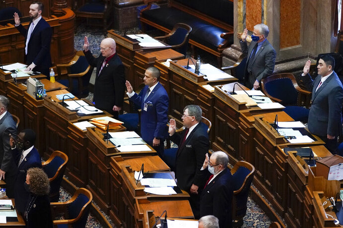 Members in the Iowa House take the oath of office during the opening day of the Iowa Legislature, Monday, Jan. 11, 2021, at the Statehouse in Des Moines, Iowa. (AP Photo/Charlie Neibergall)