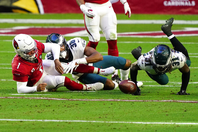 Arizona Cardinals quarterback Kyler Murray (1) fumbles the ball as Philadelphia Eagles cornerback Nickell Robey-Coleman (31) makes the recovery during the first half of an NFL football game, Sunday, Dec. 20, 2020, in Glendale, Ariz. (AP Photo/Rick Scuteri)