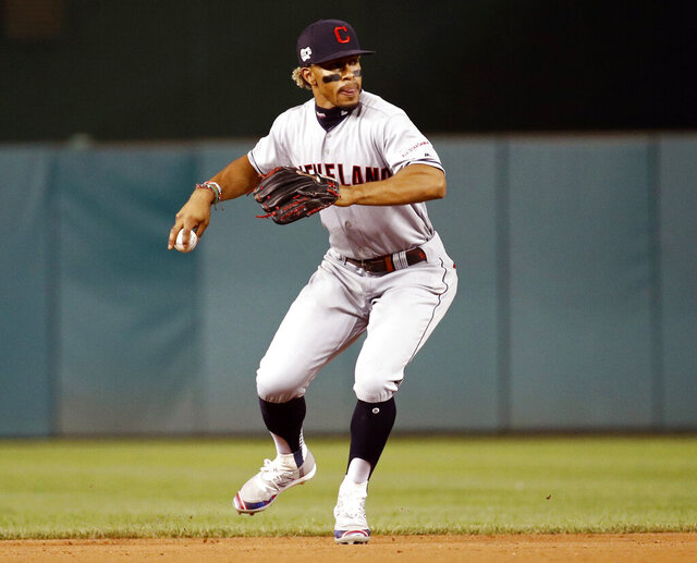 FILE - In this Friday, Sept. 27, 2019 file photo, Cleveland Indians shortstop Francisco Lindor throws out Washington Nationals' Adam Eaton at first base to end the eighth inning of a baseball game in Washington. Francisco Lindor's future with the Indians was already unclear and uncertain. The four-time All-Star shortstop, who has been the subject of trade rumors because Cleveland will probably never be able to offer him a long-term contract offer close to what he'll one day get as a free agent, made some contradictory comments while discussing his situation, Saturday, Feb. 1, 2020. (AP Photo/Patrick Semansky, File)