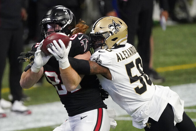 New Orleans Saints outside linebacker Kwon Alexander (58) breaks up a pass intended for Atlanta Falcons tight end Hayden Hurst (81) during the second half of an NFL football game, Sunday, Dec. 6, 2020, in Atlanta. (AP Photo/John Bazemore)