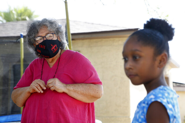 Zita Robinson, left, who's 77 and diabetic, looks at her granddaughter, 8-year-old Traris