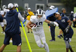 Los Angeles Rams wide receiver Cooper Kupp runs through a drill during NFL football training camp Wednesday, Aug. 7, 2019, in Napa, Calif. Both the Oakland Raiders and the Los Angeles Rams held a joint practice before their upcoming preseason game on Saturday. (AP Photo/Eric Risberg)