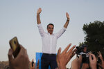 Greek opposition New Democracy party leader Kyriakos Mitsotakis waves to supporters during his main election campaign rally in Athens, on Thursday, July 4, 2019. Greeks head to the polls in early general elections on Sunday, July 7. (AP Photo/Thanassis Stavrakis)