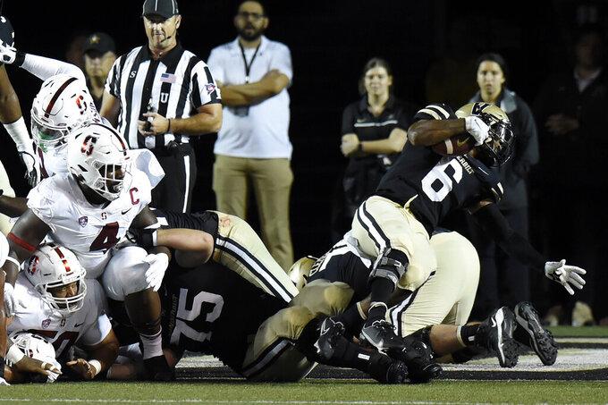 Vanderbilt running back Re'Mahn Davis (6) spins around as he runs for a touchdown against Stanford in the first half of an NCAA college football game Saturday, Sept. 18, 2021, in Nashville, Tenn. (AP Photo/Mark Zaleski)