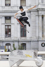 Nicolas Patino, an extreme pogo competitor, demonstrates a jump over a statue at Thomas Paine Plaza in Center City Philadelphia on Thursday, Dec. 3, 2020. (Tim Tai/The Philadelphia Inquirer via AP)
