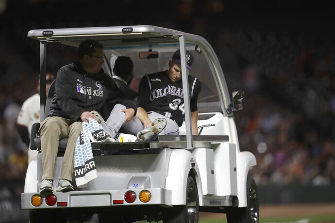 Colorado Rockies' Jeff Hoffman leaves a baseball game on a cart with a leg injury after being hit by a ball batted by San Francisco Giants' Alex Dickerson during the fourth inning Tuesday, Sept. 24, 2019, in San Francisco. (AP Photo/Ben Margot)