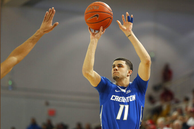 Creighton guard Marcus Zegarowski (11) shoots for three points during the first half of an NCAA college basketball game against St. John's, Sunday, March 1, 2020, in New York. (AP Photo/Kathy Willens)