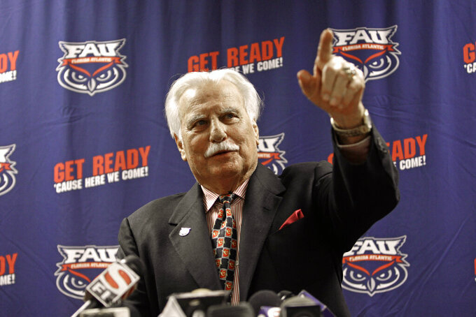 In this Aug. 11, 2011 photo, Howard Schnellenberger speaks during his announcement that he will retire from coaching after the 2011 season with Florida Atlantic University during a news conference in Boca Raton, Fla.  Schnellenberger, who coached Miami to the 1983 national championship and built programs at Louisville and Florida Atlantic, died Saturday, March 27, 2021 at the age of 87, Florida Atlantic announced.  (AP Photo/J Pat Carter)